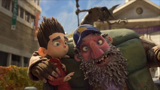 Norman (voiced by Kodi Smit-McPhee) is spooked by  Mr. Penderghast (voiced by John Goodman) in ParaNorman, the new 3D stop-motion comedy thriller from LAIKA and Focus Features, directed by Sam Fell and Chris Butler.  Credit:  LAIKA, Inc.